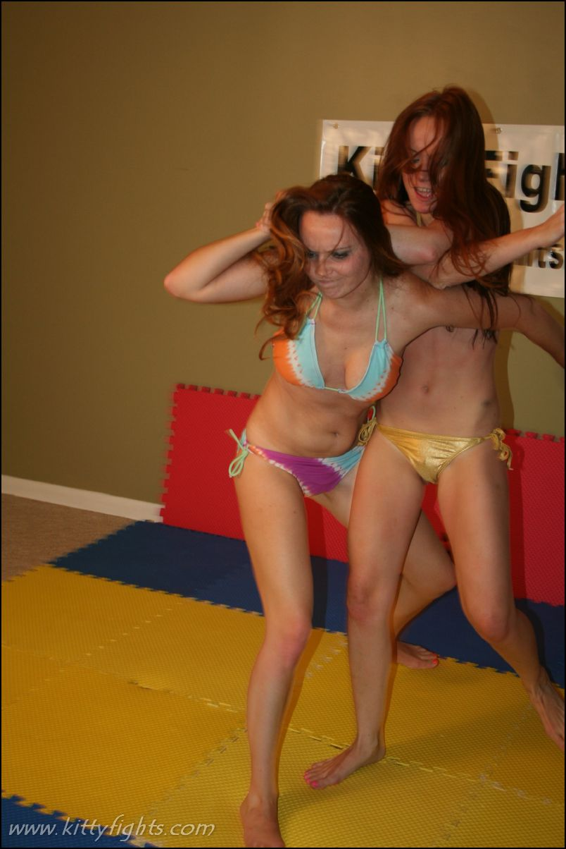image Brunette sexy wrestling puts submissive in holds